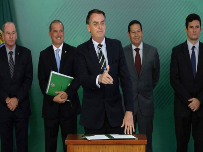 Brazil's president loosens restrictions on gun ownership.