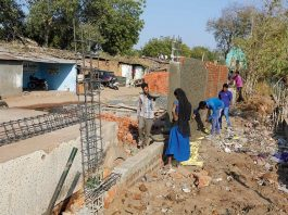 "Government is Building wall to ""Cover the Slums of Ahmedabad from the Sight of US President""_The_Policy_Times"